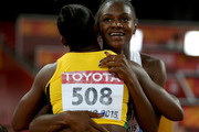 Dina Asher-Smith of Great Britain hugs Veronica Campbell-Brown of Jamaica after the Women's 200 metres Final during day seven of the 15th IAAF World Athletics Championships Beijing 2015 at Beijing National Stadium on August 28, 2015 in Beijing, China.