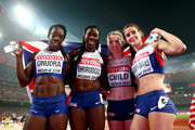 Christine Ohuruogu of Great Britain, Anyika Onuora of Great Britain, Eilidh Child of Great Britain and Seren Bundy-Davies of Great Britain celebrate after winning bronze in the Women's 4x400 Relay Final during day nine of the 15th IAAF World Athletics Championships Beijing 2015 at Beijing National Stadium on August 30, 2015 in Beijing, China.