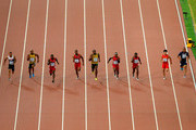 Usain Bolt of Jamaica (C) wins gold ahead of (L-R) Andre De Grasse of Canada, Asafa Powell of Jamaica, Justin Gatlin of the United States, Tyson Gay of the United States, Mike Rodgers of the United States, Trayvon Bromell of the United States, Bingtian Su of China and Jimmy Vicaut of France as they cross the finish line in the Men's 100 metres final during day two of the 15th IAAF World Athletics Championships Beijing 2015 at Beijing National Stadium on August 23, 2015 in Beijing, China.