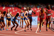 Anyika Onuora of Great Britain, Kirsten McAslan of Great Britain, Sanya Richards-Ross of Uinted States and Jessica Beard of United States change over during the Women's 4x400 Metres Relay heats during day eight of the 15th IAAF World Athletics Championships Beijing 2015 at Beijing National Stadium on August 29, 2015 in Beijing, China.