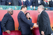 President of the People's Republic of China Xi Jinping (C) greets President of the IOC Thomas Bach (R) as outgoing president of the IAAF Lamine Diack looks on during the Opening Ceremony for the 15th IAAF World Athletics Championships Beijing 2015 at Beijing National Stadium on August 22, 2015 in Beijing, China.