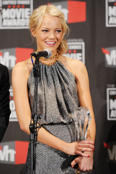 "Actress Emma Stone poses with the Best Comedy award for ""Easy A"" in the press room during the 16th annual Critics' Choice Movie Awards at the Hollywood Palladium on January 14, 2011 in Los Angeles, California."