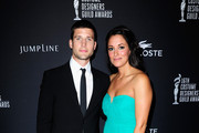 Actor Parker Young (L) and actress Angelique Cabral attend the 16th Costume Designers Guild Awards with presenting sponsor Lacoste at The Beverly Hilton Hotel on February 22, 2014 in Beverly Hills, California.
