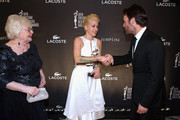 (L-R) Actress June Squibb, costume designer Trish Summerville and actor Will Forte pose with the Excellence in Fantasy Film award for The Hunger Games: Catching Fire during the 16th Costume Designers Guild Awards with presenting sponsor Lacoste at The Beverly Hilton Hotel on February 22, 2014 in Beverly Hills, California.