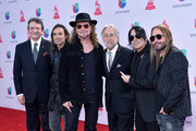 Latin Recording Academy President/CEO Gabriel Abaroa Jr. (R) and President/CEO of The Recording Academy and GRAMMY Foundation President/CEO Neil Portnow (3rd R) pose with recording artists (from L) Juan Calleros, Fher Olvera, Alex Gonzalez and Sergio Vallin of music group Mana at the 16th Latin GRAMMY Awards at the MGM Grand Garden Arena on November 19, 2015 in Las Vegas, Nevada.