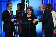(L-R) Actors Chris Cooper, Julianne Nicholson and Margo Martindale, presenter Garry Marshall, and actress Julia Roberts accept the Hollywood Ensemble Cast Award for 'August: Osage County,' as director John Wells and presenter Garry Marshall look on, onstage during the 17th annual Hollywood Film Awards at The Beverly Hilton Hotel on October 21, 2013 in Beverly Hills, California.
