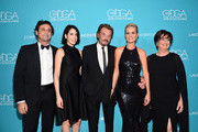 (L-R) President and Chief Executive Officer for Lacoste .North America Francis Pierrel, Coco Pierrel, singer Johnny Hallyday, actress Laeticia Hallyday and Beryl LaCoste-Hamilton attend the 17th Costume Designers Guild Awards with presenting sponsor Lacoste at The Beverly Hilton Hotel on February 17, 2015 in Beverly Hills, California.