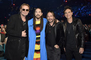 (L-R) Fher Olvera of Mana, Steve Aoki, and Sergio Vallin and Juan Calleros of Mana attend the 19th annual Latin GRAMMY Awards at MGM Grand Garden Arena on November 15, 2018 in Las Vegas, Nevada.