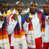 Mark Lewis-Francis Photos - (L-R) Gold medalists Leon Baptiste, Ryan Scott, Mark Lewis-Francis and Marlon Devonish of England celebrate on the podium with their medals for the men's 4 x 100 metres relay final at Jawaharlal Nehru Stadium during day nine of the Delhi 2010 Commonwealth Games on October 12, 2010 in Delhi, India. - 19th Commonwealth Games - Day 9: Athletics