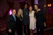 (L-R) Figure skater Scott Hamilton, Tracie Hamilton of J/P Haitian Relief Organization, musical artist Paul Beaubrun, actress Susan Yeagley, and guitarist Brad Warren attend the 1st Annual Nashville Shines for Haiti concert benefiting J/P Haitian Relief Organization - Day 2 hosted by Johnathon Arndt and Newman Arndt on April 27, 2016 in Nashville, Tennessee.