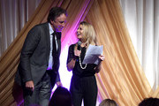 Tracie Hamilton of J/P Haitian Relief Organization (R) and comedian Kevin Nealon speak onstage during the 1st Annual Nashville Shines for Haiti concert benefiting J/P Haitian Relief Organization - Day 2 hosted by Johnathon Arndt and Newman Arndt on April 27, 2016 in Nashville, Tennessee.