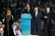 The President of the International Committee of Mediterranean Games Amar Addadi (2nd L), IOC Executive Board Member Mario Pescante (2nd R) and IOC President Jacques Rogge (R) attend the 2009 Mediterranean Games opening ceremony on June 26, 2009 in Pescara, Italy.