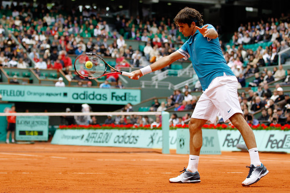 Roger Federer of Switzerland plays a backhand during the men's singles fourth round match between Roger Federer of Switzerland and Stanislas Wawrinka of Switzerland at the French Open on day eight of the French Open at Roland Garros on May 30, 2010 in Paris, France.