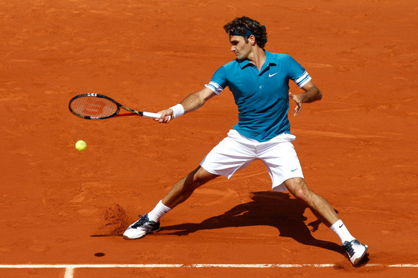 Roger Federer of Switzerland plays a forehand during the men's singles third round match between Roger Federer of Switzerland and Julian Reister of Germany on day six of the French Open at Roland Garros on May 28, 2010 in Paris, France.