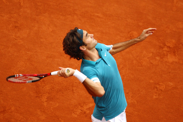Roger Federer of Switzerland serves during the men's singles quarter final match between Robin Soderling of Sweden and Roger Federer of Switzerland at the French Open on day ten of the French Open at Roland Garros on June 1, 2010 in Paris, France.