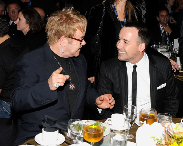 Musician Elton John and David Furnish attend the  2010 MusiCares Person Of The Year Tribute To Neil Young at the Los  Angeles Convention Center on January 29, 2010 in Los Angeles,  California