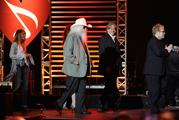 Musicians Leon Russell (C) and Elton John (R)  onstage at the 2010 MusiCares Person Of The Year Tribute To Neil Young  at the Los Angeles Convention Center on January 29, 2010 in Los Angeles, California