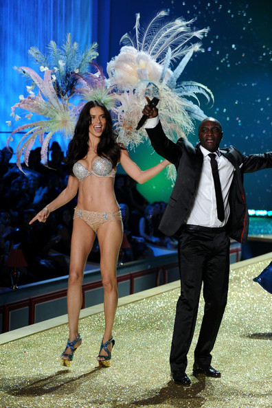 Model Adriana Lima wearing $2 million fantasy bra by Damiani and musician Akon walk the runway during the 2010 Victoria's Secret Fashion Show at the Lexington Avenue Armory on November 10, 2010 in New York City.