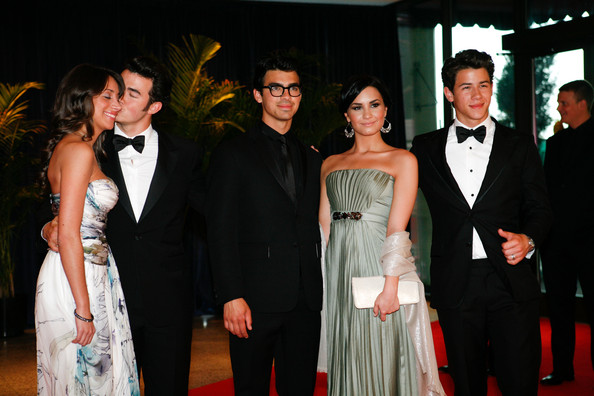 The Jonas Brothers, Kevin Jonas (L) with wife Danielle Deleasa, Joe Jonas (C) with girlfriend Demi Lovato ,and Nick Jonas (R), arrive at the White House Correspondents' Association dinner on May 1, 2010 in Washington, DC. The annual dinner featured comedian Jay Leno and was attended by President Barack Obama and First Lady Michelle Obama.
