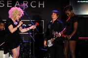 Singers Cyndi Lauper and Estelle perform onstage during the 2010 amfAR New York Inspiration Gala at The New York Public Library on June 3, 2010 in New York, New York.