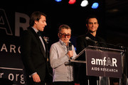 Rodman Primack, creative director of Barneys Simon Doonan and Cheyenne Jackson speak onstage at the 2010 amfAR New York Inspiration Gala at The New York Public Library on June 3, 2010 in New York, New York.