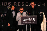 (L-R) Rodman Primack, creative director of Barneys Simon Doonan and actor Cheyenne Jackson speak onstage at the 2010 amfAR New York Inspiration Gala at The New York Public Library on June 3, 2010 in New York, New York.