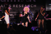 (L-R) Singer Kelly Rowland, Cyndi Lauper and Estelle performs at the 2010 amfAR New York Inspiration Gala at The New York Public Library on June 3, 2010 in New York, New York.