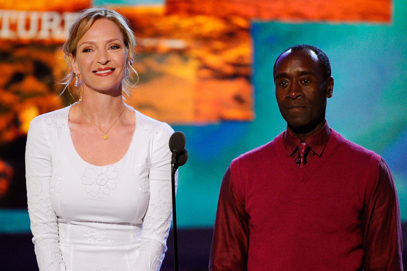 Actors Uma Thurman and Don Cheadle present onstage during the 2011 Film Independent Spirit Awards at Santa Monica Beach on February 26, 2011 in Santa Monica, California.