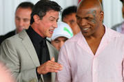 Sylvester Stallone and Mike Tyson speak prior to the 2011 International Boxing Hall of Fame Inductions at the International Boxing Hall of Fame on June 12, 2011 in Canastota, New York. Both Stallone and Tyson were 2011 Inductees.