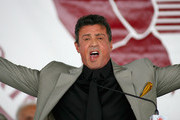 "Sylvester Stallone gives a ""Yo Adrienne""  during the 2011 International Boxing Hall of Fame Inductions at the International Boxing Hall of Fame on June 12, 2011 in Canastota, New York. Stallone was a 2011 inductee."