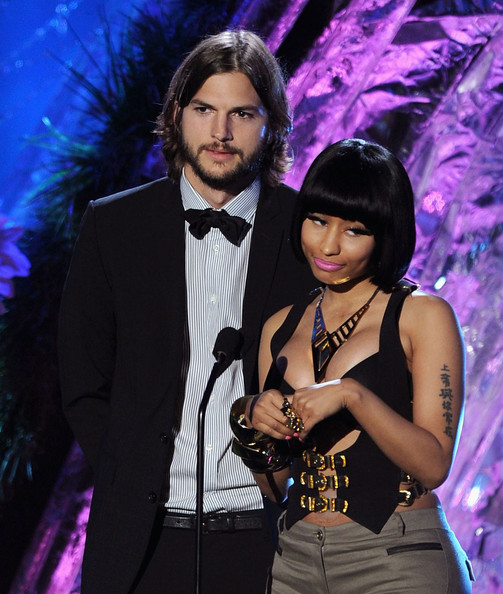 Actor Ashton Kutcher (L) and singer Nicki Minaj speak onstage during the 2011 MTV Movie Awards at Universal Studios' Gibson Amphitheatre on June 5, 2011 in Universal City, California.