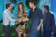 (L-R) Actors Shia LaBeouf, Rosie Huntington-Whiteley, Josh Duhamel, and Patrick Dempsey speak onstage during the 2011 MTV Movie Awards at Universal Studios' Gibson Amphitheatre on June 5, 2011 in Universal City, California.