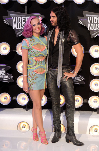 Singer Katy Perry (L) and husband Russell Brand arrive at the 2011 MTV Video Music Awards at Nokia Theatre L.A. LIVE on August 28, 2011 in Los Angeles, California.