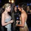 She glams up with Ashley Benson.