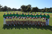 Members of the U.S. Team pose alongside their caddies during a practice round prior to the start of the 2011 Presidents Cup at Royal Melbourne Golf Course on November 15, 2011 in Melbourne, Australia.