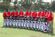 (L-R) The U.S. Team captain Fred Couples, Bill Haas, Jim Furyk, Dustin Johnson, Matt Kuchar, Hunter Mahan, Phil Mickelson, Webb Simpson, Steve Stricker, David Toms, Nick Watney, Bubba Watson, Tiger Woods, U.S. Team captain's assistant John Cook and U.S. Team captain's assistant Jay Haas pose with their golf bags on the driving range during a practice round prior to the start of the 2011 Presidents Cup at Royal Melbourne Golf Course on November 16, 2011 in Melbourne, Australia.