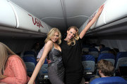Kate Upton and Anne V. LOVE packing their belongings in the overhead compartments. - Models Being Excited About Things That Are Not Exciting