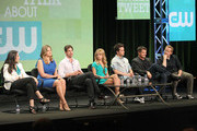 (L-R) Executive Producer Gina Girolamo, actors Natasha Henstridge, Gale Harold, Britt Robertson and Thomas Dekker and Executive Producers Kevin Williamson and Andrew Miller speak during 'The Secret Circle' panel during the CW portion of the 2011 Summer TCA Tour held at the Beverly Hilton Hotel on August 4, 2011 in Beverly Hills, California.
