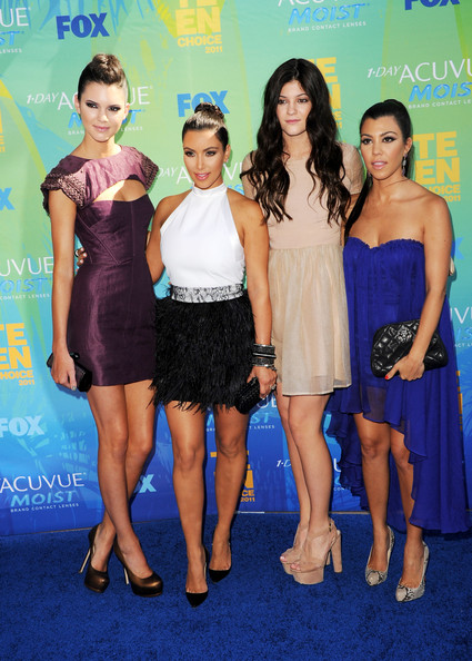 (L-R) TV personalities Kendall Jenner, Kim Kardashian, Kylie Jenner and Kourtney Kardashian arrive at the 2011 Teen Choice Awards held at the Gibson Amphitheatre on August 7, 2011 in Universal City, California.