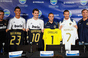 Real Madrid players  Cristiano Ronaldo, (2L) goalkeeper Iker Casillas and coach Jose Mourinho (L) pose with Los Angeles Galaxy players Landon Donovan, David Beckham (2R) and coach Bruce Arena after a news conference to announce the Herbalife World Football Challange 2011 friendly soccer torunament between 13 european and US soccer clubs on July 12, 2011 in Los Angeles, California. The Los Angeles Galaxy will play Real Madrid in a friendly soccer match on Saturday.