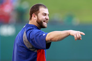 Mike Napoli #25 of the Texas Rangers stands on the field during batting practice prior to Game Five of the MLB World Series against the St. Louis Cardinals at Rangers Ballpark in Arlington on October 24, 2011 in Arlington, Texas.