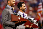 (L-R) Matt Kemp of the Los Angeles Dodgers and Jose Bautista of the Toronto Blue Jays are honored on the field with the National and American League 2011 Hank Aaron Award priorto Game Five of the MLB World Series between the St. Louis Cardinals and the Texas Rangers at Rangers Ballpark in Arlington on October 24, 2011 in Arlington, Texas.