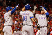 (L-R) Elvis Andrus #1, Mitch Moreland #18 and Josh Hamilton #32 of the Texas Rangers celebrate after a Hamilton two-run home run in the 10th inning during Game Six of the MLB World Series against the St. Louis Cardinals at Busch Stadium on October 27, 2011 in St Louis, Missouri.
