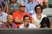 (L-R) Gold Coast Suns' AFL captain Gary Ablett, footballer Harry Kewell and his wife Sheree Murphy watch Novak Djokovic of Serbia and Rafael Nadal of Spain in their men's finals match during day fourteen of the 2012 Australian Open at Melbourne Park on January 29, 2012 in Melbourne, Australia.