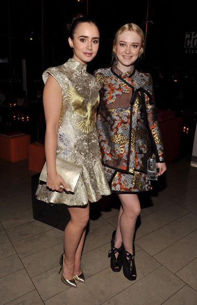 Actresses Lily Collins and Dakota Fanning attend the 2012 CFDA Fashion Awards at Alice Tully Hall on June 4, 2012 in New York City.