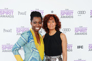 Actresses Adepero Oduye (L) and Tracee Ellis Ross arrive at the 2012 Film Independent Spirit Awards on February 25, 2012 in Santa Monica, California.