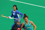 Farah Ayuni Yahya of Malaysia and Brooke Peris of the Jillaroos contest for the ball in the womens Australia u21 Jillaroos v Malaysia game during day two of the 2012 International Super Series at Perth Hockey Stadium on November 23, 2012 in Perth, Australia.