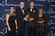 (L-R) Jackie Robinson Foundation President and CEO Della Britton Baeza, ROBIE Humanitarian Award winner Paul Tagliabue, Jackie Robinson Foundation Chairman Leonard S. Coleman Jr. and Rachel Robinson pose with the award at the Jackie Robinson Foundation Awards Gala at The Waldorf=Astoria on March 5, 2012 in New York City.