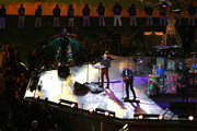 (L-R) Will Champion, Chris Martin, Jonny Buckland and Guy Berryman of Coldplay perform during the closing ceremony on day 11 of the London 2012 Paralympic Games at Olympic Stadium on September 9, 2012 in London, England.