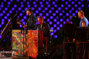 (L-R) Will Champion, Chris Martin and Jonny Buckland  of Coldplay perform during the closing ceremony on day 11 of the London 2012 Paralympic Games at Olympic Stadium on September 9, 2012 in London, England.